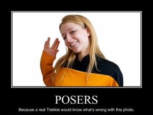 Oh, that's EASY!  What's wring with the picture is that a pretty girl who's not castmember is wearing a Starfleet uniform.